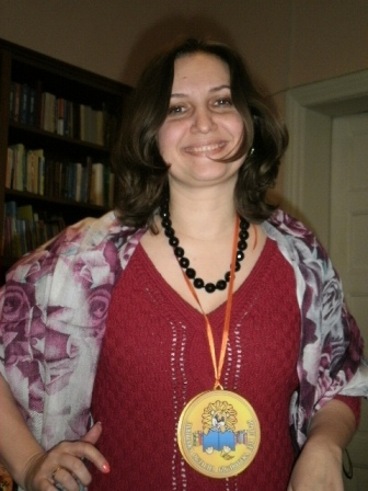 Мар'яна Савка з медаллю